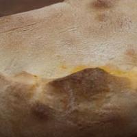 Calzone con prosciutto e scamorza